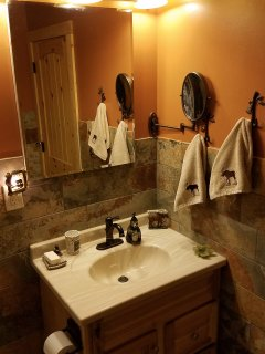 Bathroom w/ tile & sink.