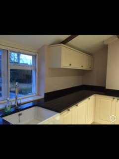 Newly fitted kitchen with dishwasher, washer, microwave and fridge all in built and granite tops