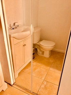 2nd bathroom. 24' travertine tile. Italian desigh vanity with XL sink. Mirrored wall!!