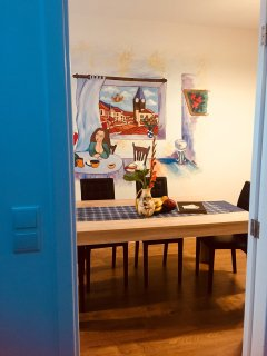Portuguese style kitchen and living room where can also sleep two people.Here you will feel very com