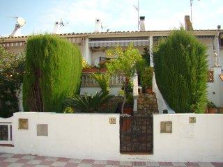 Casa sencilla con 2 terrazas
