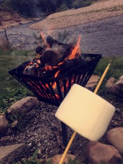 Roast marshmallows on the fire pit down by the river