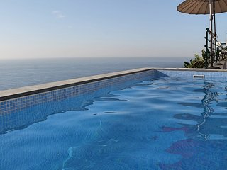 Perched above village with heated pool & ocean views | Casa Jardim Mar
