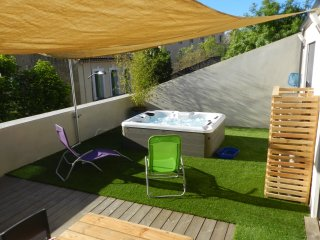 APPARTEMENT AVEC SPA SUR TERRASSE PRIVATIVE