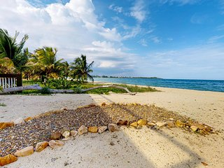Gorgeous four-suite oceanfront villa with a private beach right in town!