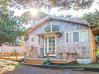 Bright Cottage Close to Town and Steps to the Beach has Wrap-Around Deck and