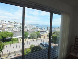 Panoramic view of the town and harbour from the light spacious living space on the middle floor.