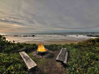 Gather around the seaside fire-pit.