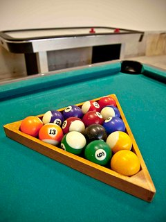 Grab your cues for pool.