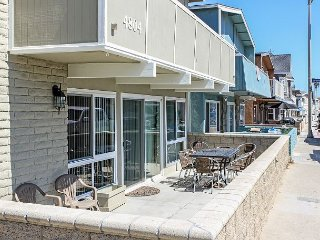 Renovated Lower Beach Condo with Patio, BBQ! 1 House from the Ocean!