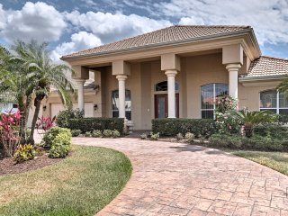 Lush plantings and beautiful landscaping invites you up to this beautiful Florida home.