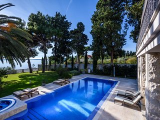 Luxury Villa Castello Split with pool by the sea at the beach in Split