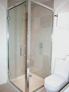 The separate shower cubicle in the upstairs bathroom