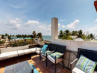 Breezy & elegant condo w/ ocean view, private patio, and rooftop hammock garden