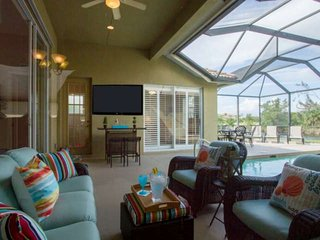 Fabulous upscale Briarwood lake view pool home w/outdoor TV, bar, dining, & ente