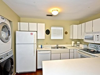Dog-friendly condo w/ shared pool - close to shops, beaches & more!