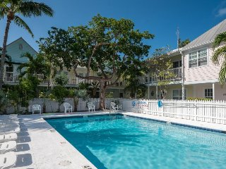 Lovely condo w/ a private patio, shared pool & perfectly walkable location!