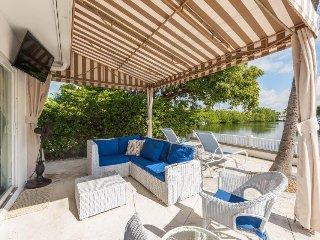 Upscale, waterfront villa w/ private pool, sun-drenched patio, & boat slip
