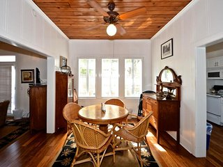 Classic Key West cottage featuring shared pool, courtyard, covered front porch