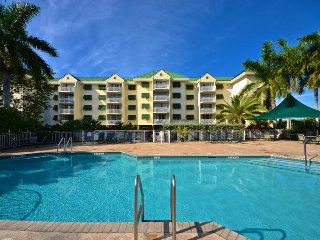 East-facing dog-friendly condo w/shared pool, tennis, private balcony, & parking