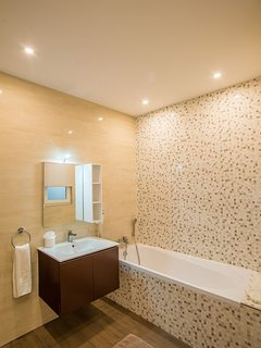 Main Bathroom with; vanity and hair dryer