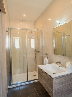 En-suite Shower of Bedroom 2 with; vanity and hair dryer