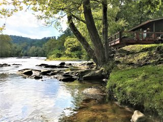 *Riverfront cabin overlooking the trout stocked river!*