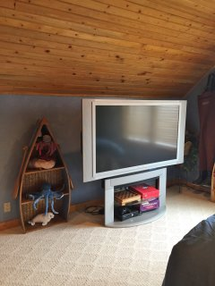 large screen TV, games, and toys