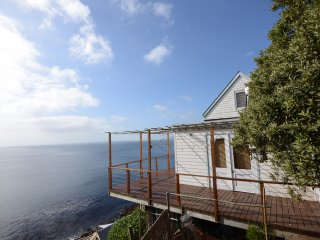Whale Cove Cottage - incredible ocean views from all rooms across False Bay