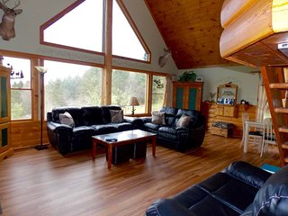 Amidst the Mountains Chalet - A secluded log cabin situated on 76 private acres.