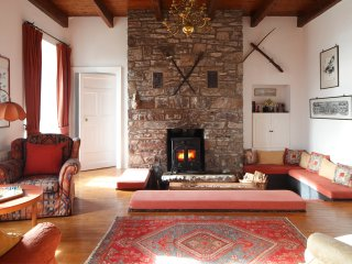 Westcove House sitting room with sunken seating area around wood burning stove