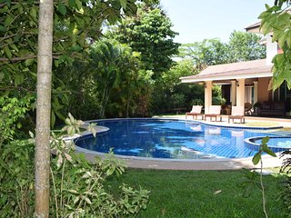 Secluded landscaped tropical gardens