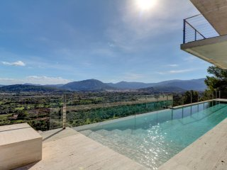 Ultra modern luxury villa with infinity pool, built into the mountain side