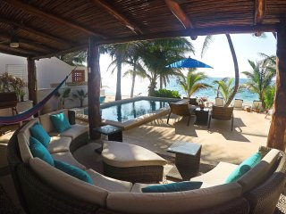 Paradisiacal front beach family house with private pool