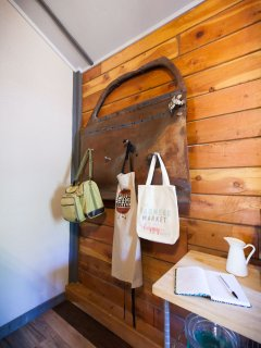 We re-purposed an old car door riddled with bullet holes! Check out the fun picnic basket!