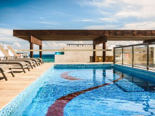 Beach Escape w Roof Top Ocean View Pool - Klem 310