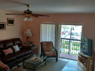 Steps away from the beach, furnished property, heated pool, laundry room.