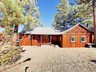 Classic 2BR 1930s Cabin with Hot Tub & Fire Pit—Walk to Lake and Village