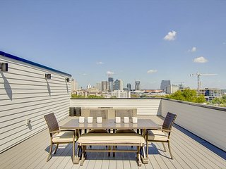 Brand-New 4BR w/ Rooftop Deck and City Views