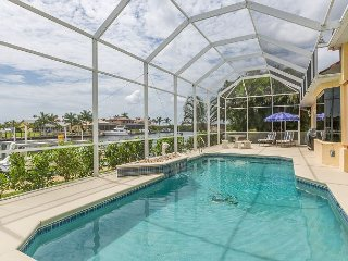 Canal-Front 3BR w/ Pool & Dock – Close to Tarpon Point Marina & Restaurants
