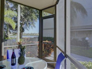 Brand New, Walk to Beach, Wifi, Water view from patio, Heated Pool, On Trolley