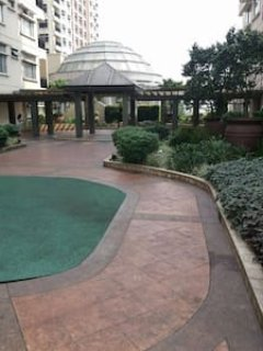 manicured gardens and paved walkways