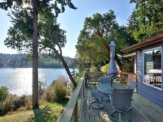 Spectacular waterfront home with Holmes Harbor view! 3 bed, 3 bath.