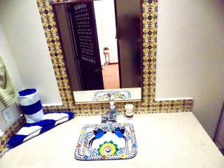 Each bathroom has a beautiful ceramic sink and drinkable water