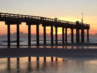 Soak up beautiful sunsets from the beach, which is walking distance from the condo.