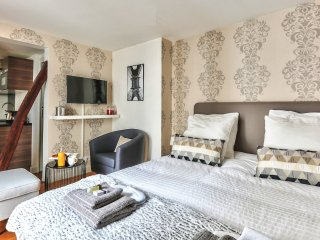 The bedroom is equipped with double-glazed windows