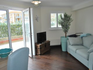 Ground floor Brighton Marina apartment with a West facing terrace & FREE parking