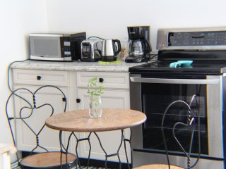 LG oven, electric hot water pot,toaster, 12 c coffee pot, cafe table