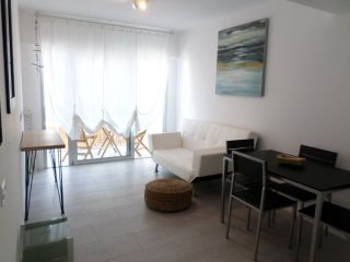 Spacious Sunset Beach apartment in Corralejo with shared garden & balcony.