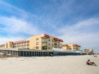 Lovely beachfront condo features shared pool & clubhouse!
